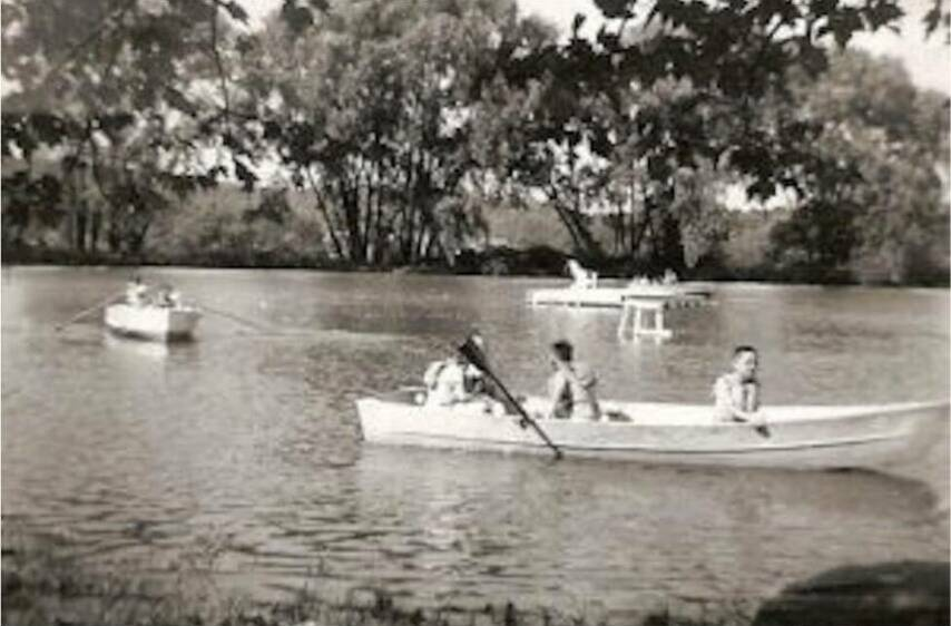 Old photo kids on canoe