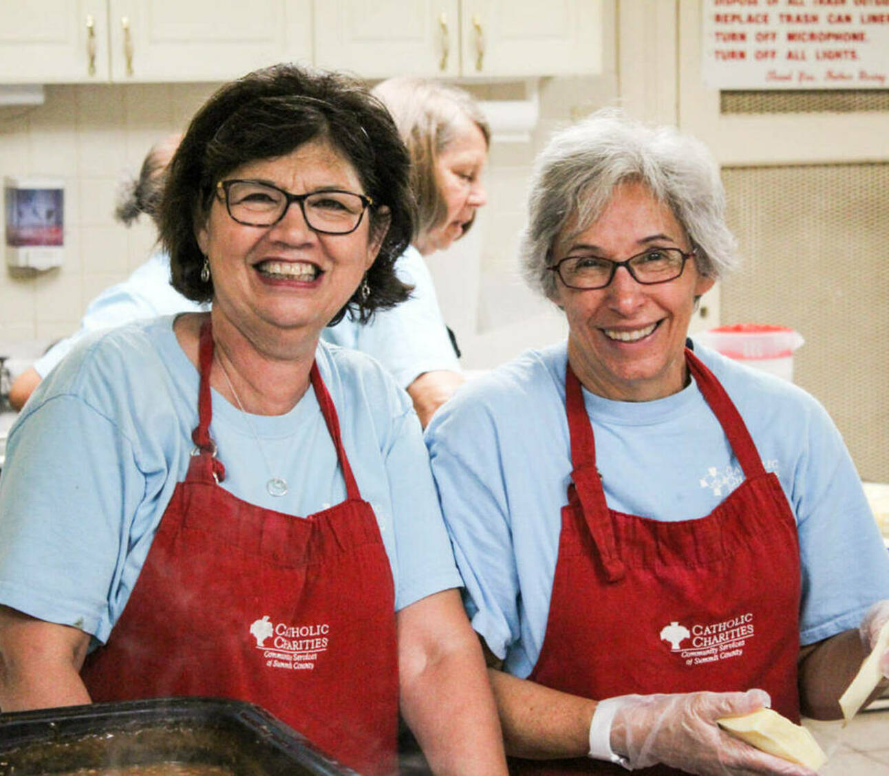 Smiling women in aprons